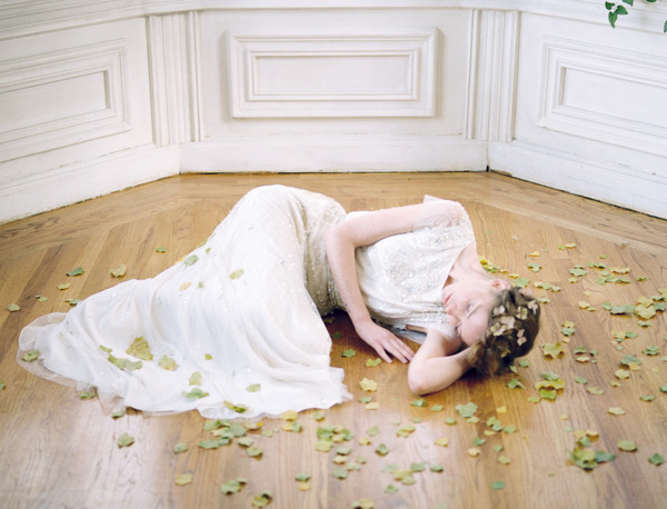 Bride laying on floor with leaves