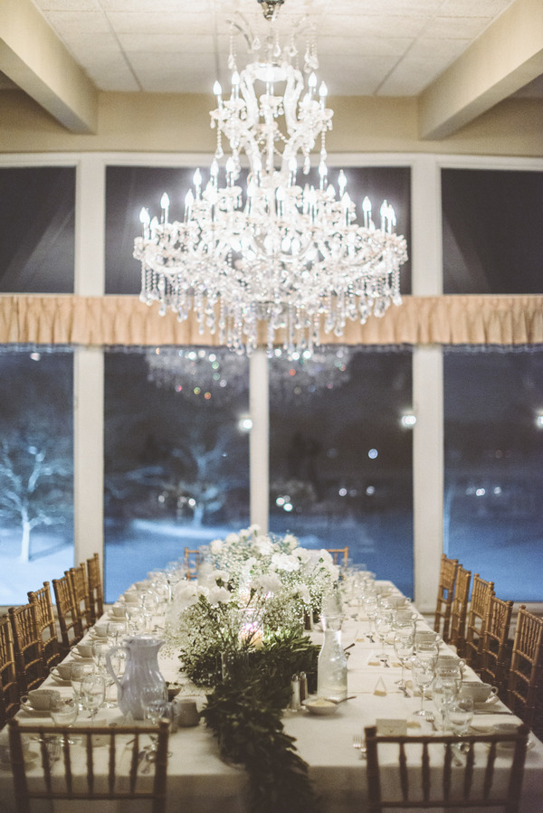 Chandelier over wedding table