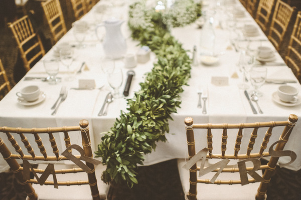Long foliage wedding table centrepiece