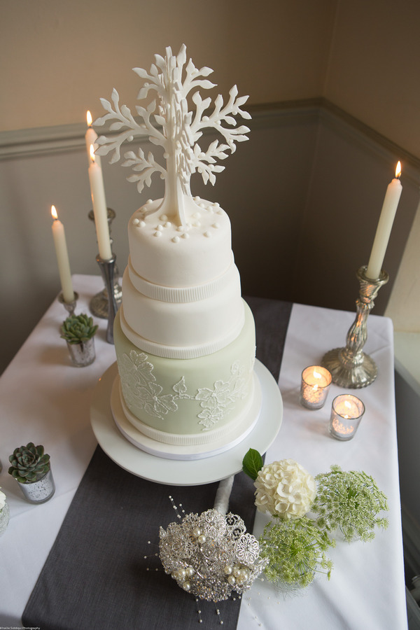 Elegant wedding cake with tree topper