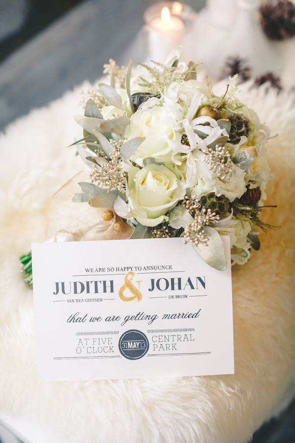 Wedding invitation and winter bouquet