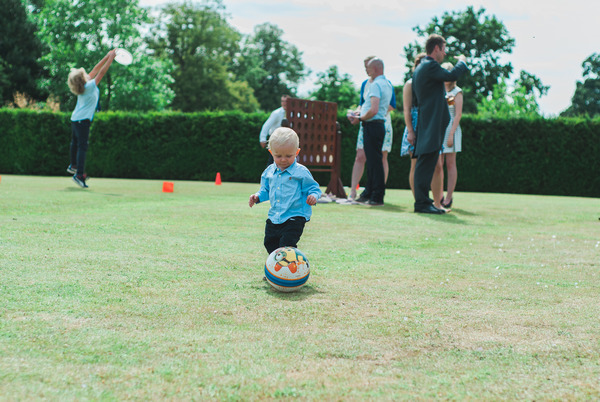 Young boy playing with ball at Narborough Hall Gardens