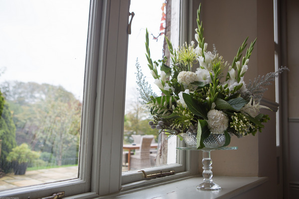 Vase of flowers on window ledge at The Alverton Hotel