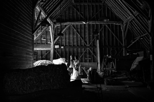Bride and groom in barn at Layer Marney Tower