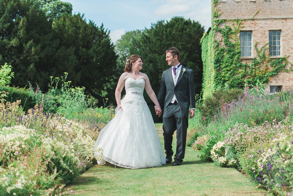 Bride and groom walking around Narborough Hall Gardens