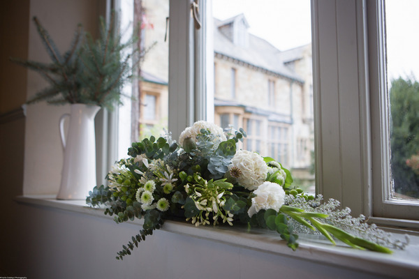 Elegant wedding flower arrangement in white and green