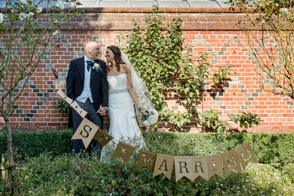 Bride and groom in grounds of Layer Marney Tower