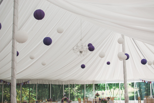 Purple and white lanterns hanging from marquee