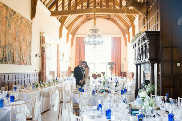Bride and groom in wedding breakfast room at Layer Marney Tower