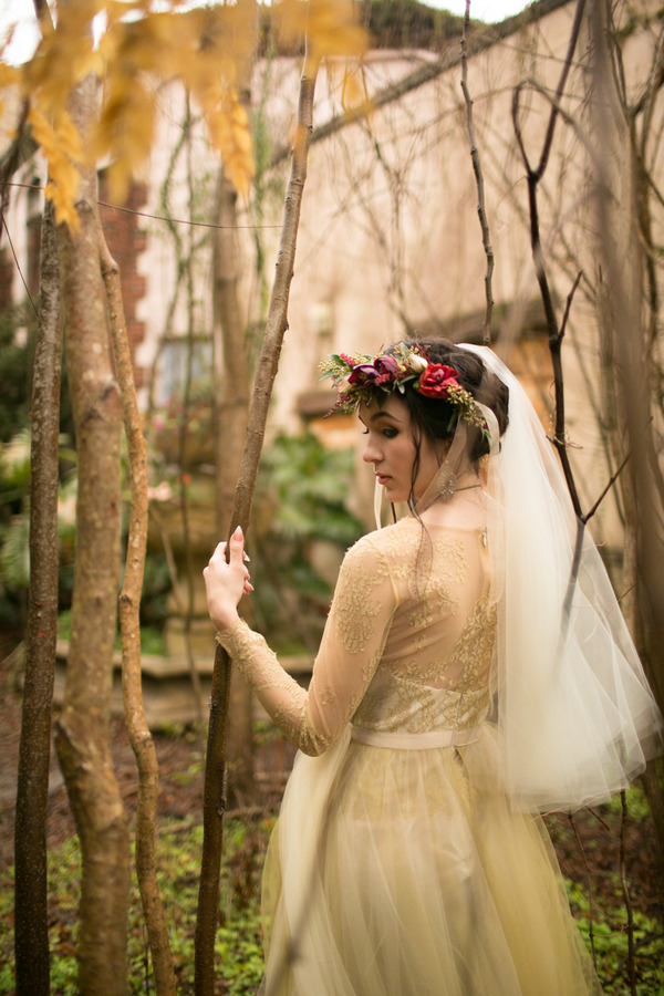 Bride walking through trees