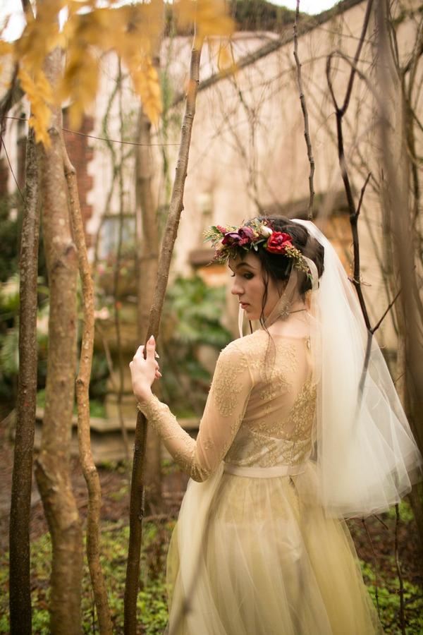 Bride walking through trees