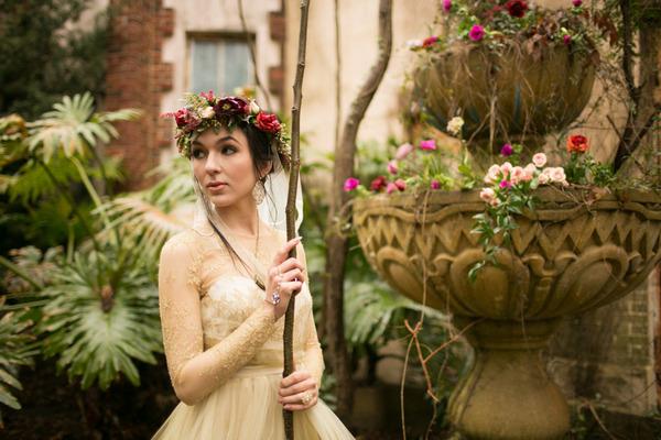 Bride standing in garden