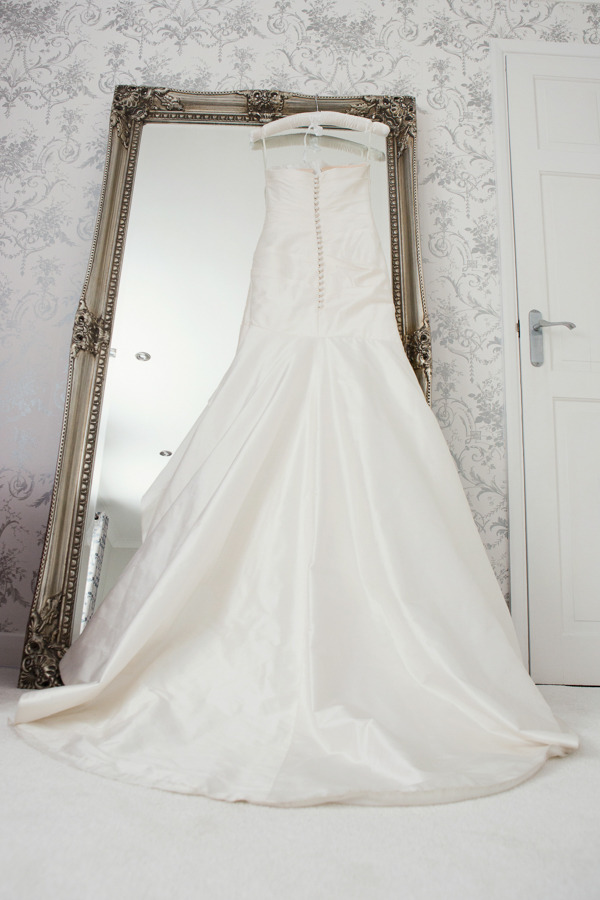 Wedding dress hanging on mirror