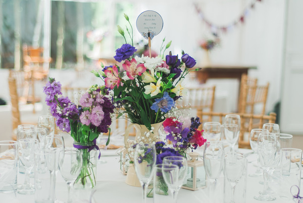 Purple wedding table flowers