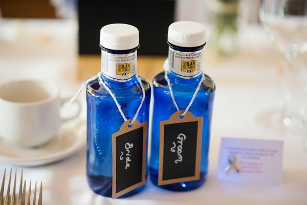 Blue glass bottles on wedding table