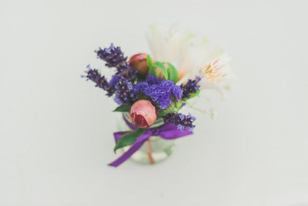 Small vase of purple flowers