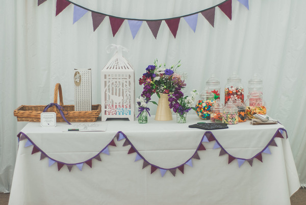 Wedding sweet table with purple bunting