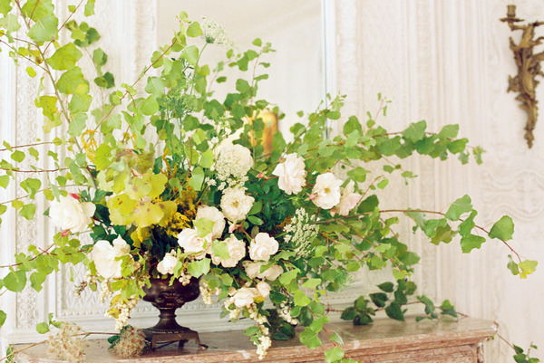 Large floral and foliage display on fireplace