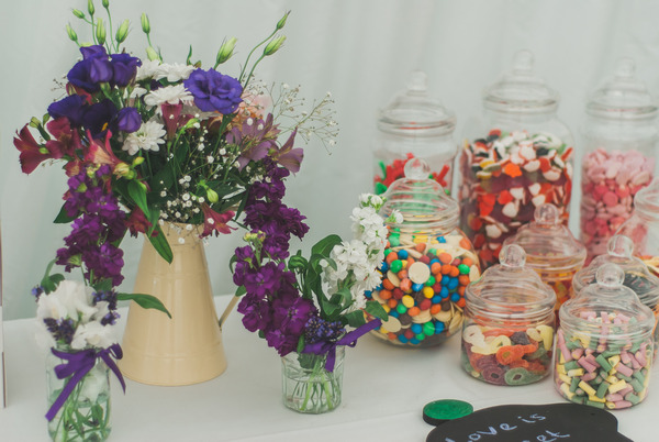 Purple flowers and jars of sweets