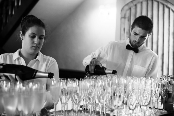 Pouring champagne for wedding speeches