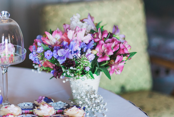 Purple and pink flowers on table