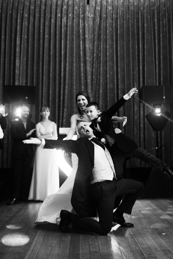 Bride, groom and pageboy on dance floor