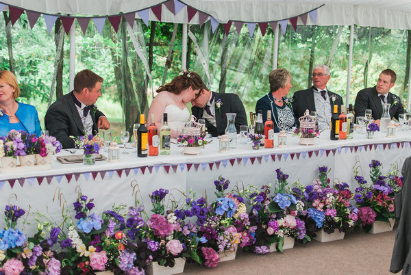 Wedding top table with flowers in front