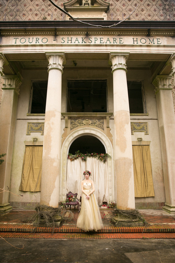 Bride standing in front of pillars