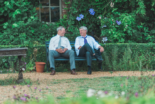 Wedding guests relaxing at Narborough Hall Gardens