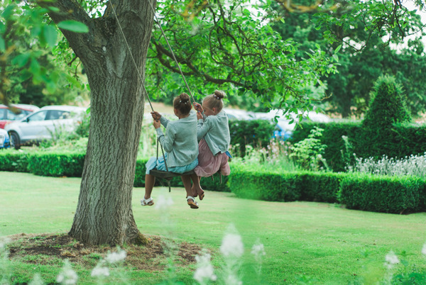 Children on rope swing at Narborough Hall Gardens