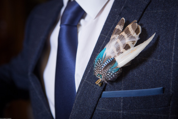 Groom's feather buttonhole
