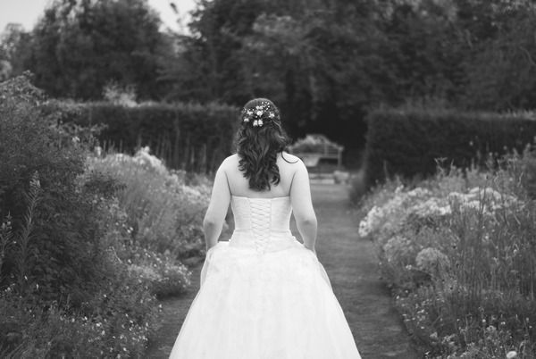 Bride walking around Narborough Hall Gardens