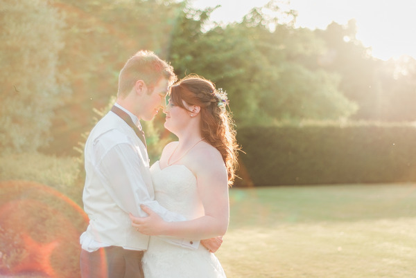 Bride and groom in hazy sunshine at Narborough Hall Gardens