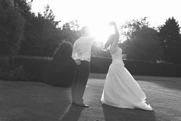 Bride twirling at Narborough Hall Gardens