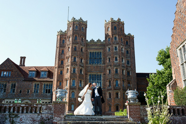 Bride and groom outside Layer Marney Tower