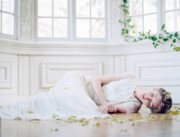 Bride laying on floor surrounded by leaves