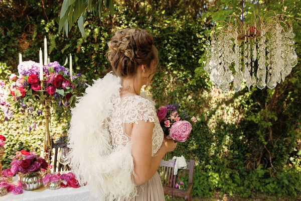 Bride with lace detail wedding dress and white shrug