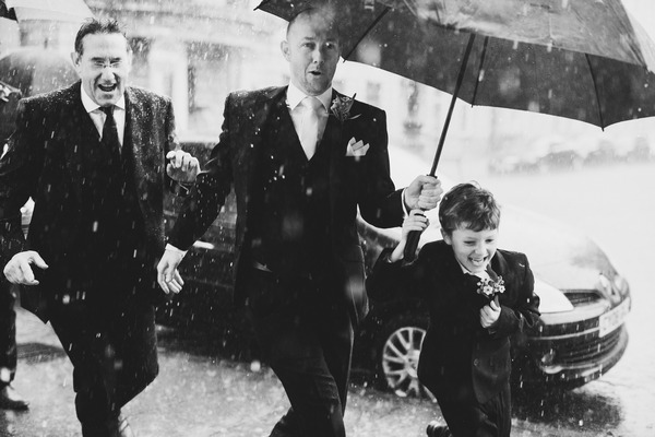 Groom and pageboy running in the rain - Picture by Sam Gibson Photography