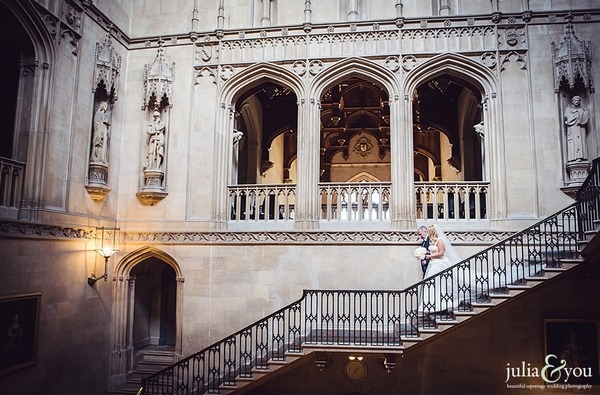 Father walking bride down stairs at grand wedding venue - Picture by Julia and You