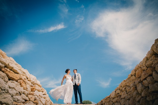 Bride and groom with beautiful blue sky behind them - Picture by Eclection Photography