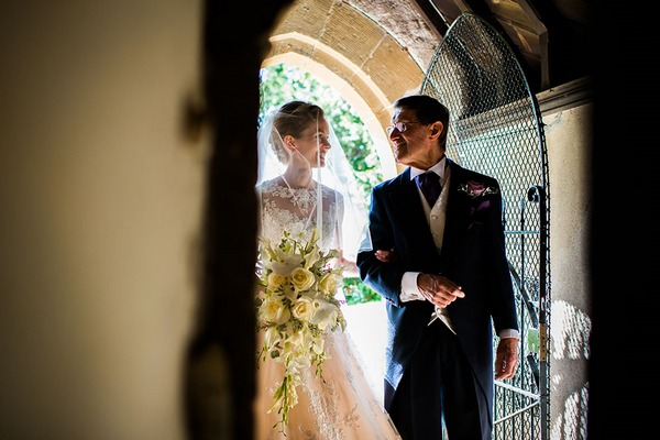 Father and bride walking into church - Picture by Makowski Photography