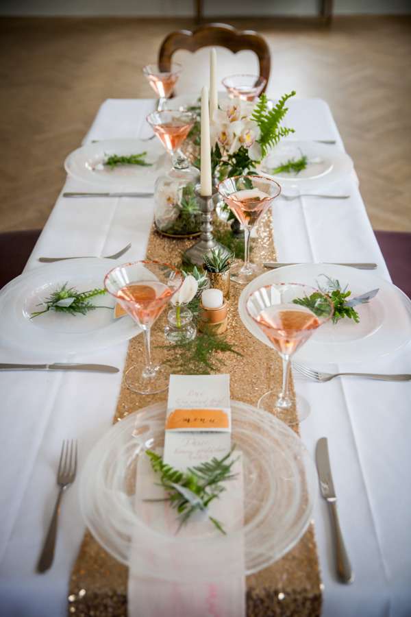 Wedding table dressed with copper details and foliage