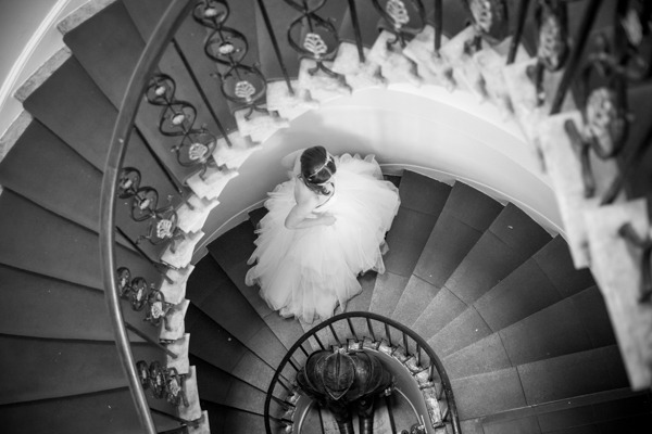 Bride walking up staircase at Belair House