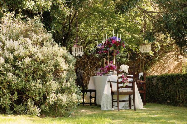Styled wedding table in garden of Tros Yr Afon