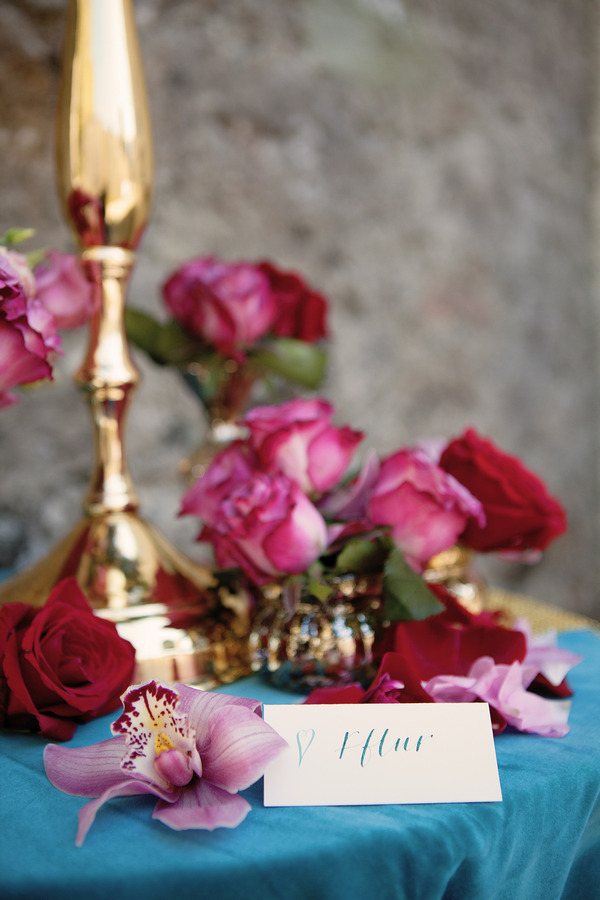 Roses and name card on small table