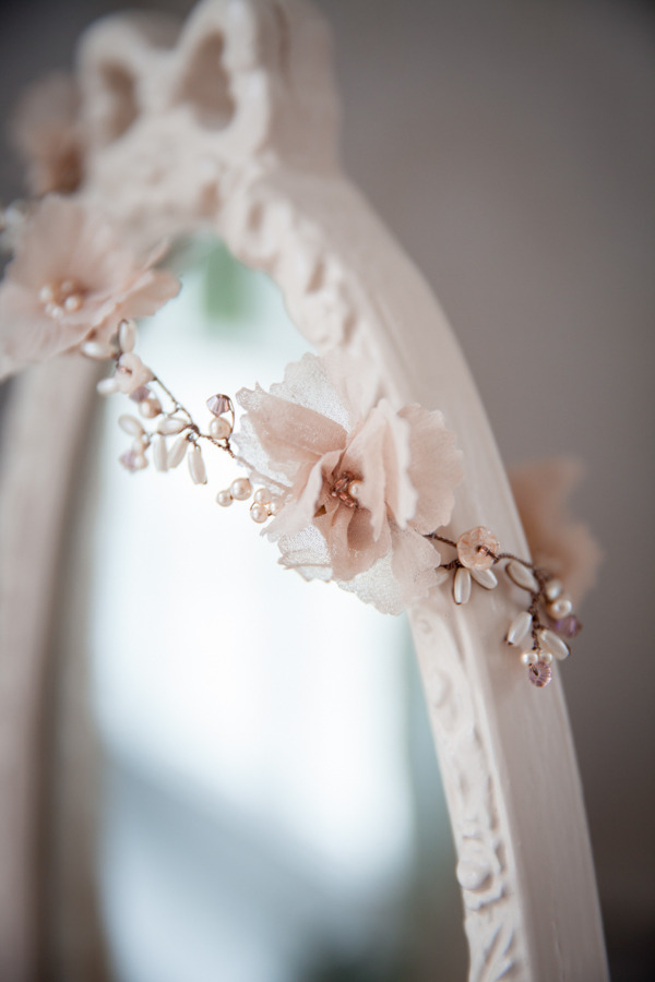 Flower bridal accessory over mirror
