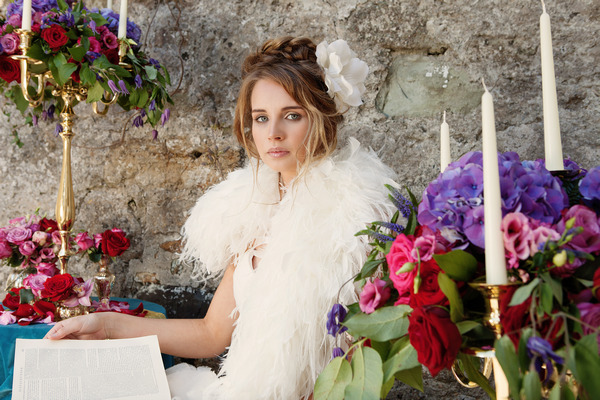 Bride with shrug sitting with book