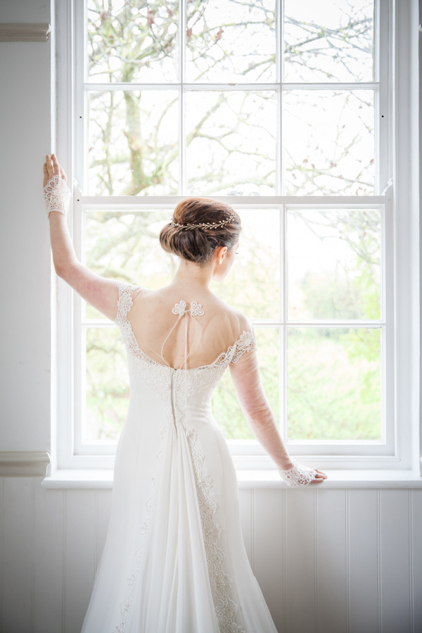 Bride standing by window at Belair House