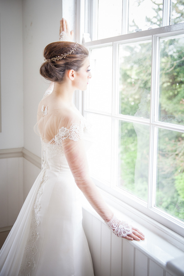 Bride looking out of window at Belair House