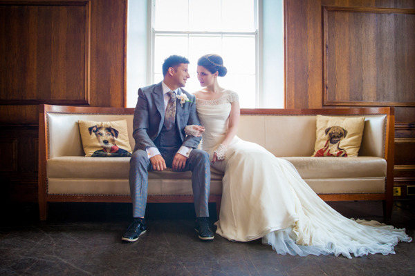 Bride and groom sitting on couch at Belair House